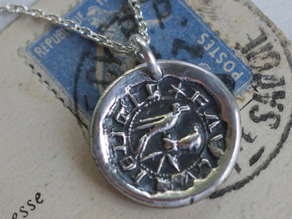 bird in the hand wax seal necklace