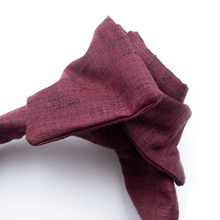 luxe handmade wide cut headband with wire frame and square ends in wine colored summer fabric.