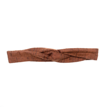 Handmade, skinny, wire framed headband with tapered ends in machine washable brown khadi, styled as turban. Flexible wired head wrap allows the wearer to style however they like. Wire uniquely forms to the exact shape of the wearer's head to eliminate slipping and tension.