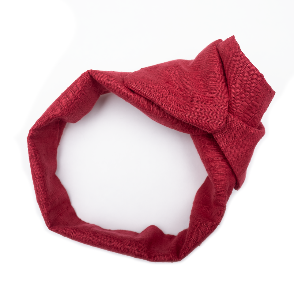 Handmade, wide cut turban headband with flexible wire frame and flat ends in machine washable deep red Khadi. Wire allows the wearer to style this headband multiple ways and forms to the exact shape of their head, eliminating unwanted slipping and discomfort caused by traditional headbands.