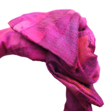 Close up view of Pink Patterned Silk Maxi Wire-Framed Headband  tied into a rosette on a white background. Luxury, Premium, Silk Headbands. Suitable for all hair types. Adjustable shape and fit, creative styling possibilities, Summer hair, summery headband, easter, valentines day, new years eve, wedding, wedding guest, kentucky derby, spring, fall, winter, new years eve, office, work, boutique, brunch, artisinal, baby shower, beach, pool party, vacation, resort.