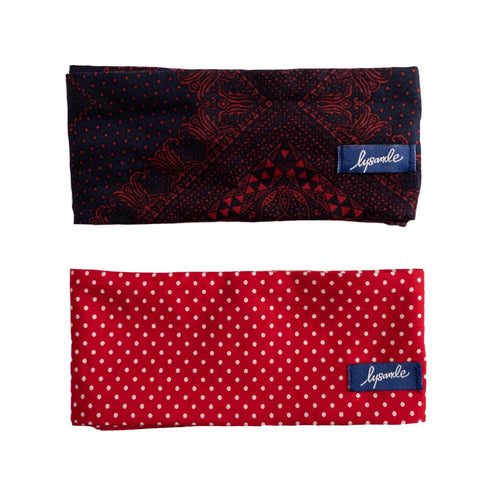 Overview of two wire freamed headbands folded into rectangles: one is navy with a red bandana print, the other is bright red with white polka dots.  Wide head wraps with election day theme. Woman's suffrage, voting accessories, voting swag.