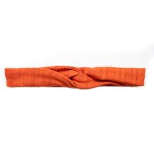 "Overview of a bright nectarine orange, wire-framed, scarf style headband tied into a turban style, on a white background. Wire framing allows you to sculpt or shape headband into any shape you can think of, including: rosette, skinny and flat like Blair Waldorf, or different types of bows. Flexible shaping of the headband allows for unique, ""headache free"" comfort and fit, that's easy to style and go, making it ideal for someone who is busy or traveling."