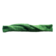"Overview of a brilliant, deep green, wire-framed, scarf style headband tied into a turban style, on a white background. Wire framing allows you to sculpt or shape headband into any shape you can think of, including: rosette, skinny and flat like Blair Waldorf, or different types of bows. Flexible shaping of the headband allows for unique, ""headache free"" comfort and fit, that's easy to style and go, making it ideal for someone who is busy or traveling."