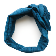 Overview image of Marine Blue Maxi Wire-Framed Headband, twisted into a rosette, on a white background. Everyday wear, suitable for all hair types. Adjustable wired head-wrap hair scarf for headache free fit and multi-style wear. Luxury Hair Accessories. Premium Headbands. Wear flat, as a rosette, in a knot, bow, or turban style. Twist around buns for laidback festival hair or to go to the beach. Artisan made, Women Owned Business. Special occasion hair, wear to work, wedding season.