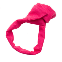 "Overview of a warm-toned bright pink, wire-framed, scarf style headband tied into a rosette, on a white background. Wire framing allows you to sculpt or shape headband into any shape you can think of, including: trendy turban style, wide and flat like Brigitte Bardot, or different types of bows. Flexible shaping of the headband allows for unique, ""headache free"" comfort and fit, that's easy to style and go, making it ideal for someone who is busy or traveling."