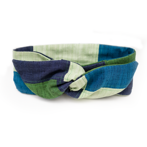 Overview of a luxurious blue and green patchwork wire headband.
