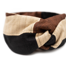 Luxurious khadi black, brown, and beige patchwork wire headband.