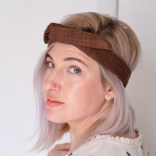 Beautiful woman wears brown wire khadi headband