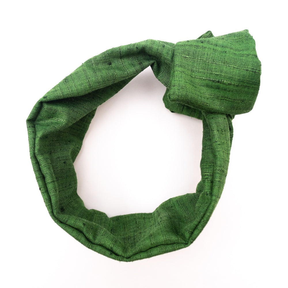 Overview of a bright emerald green, wire-framed, scarf style headband tied into a rosette, on a white background. Wire framing allows you to sculpt or shape headband into any shape you can think of, including: trendy turban style, wide and flat like Brigitte Bardot, or different types of bows. Flexible shaping of the headband allows for unique,