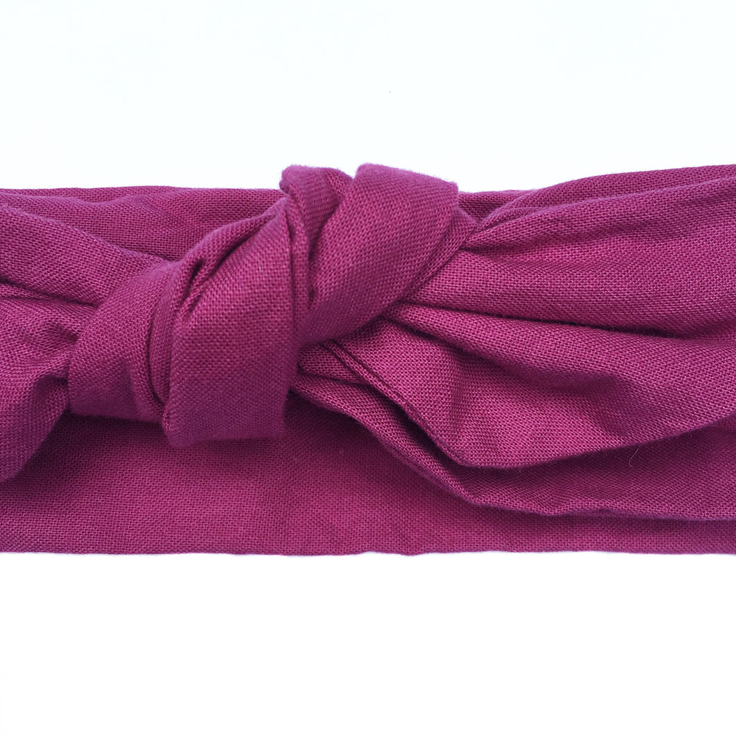 Close up of a cotton magenta colored headband, purple pink wired head wrap, berry adjustable headscarf,  Plum colored headache free hair accessory. 36 inches long by 2.5 inches wide mulberry hair scarf.