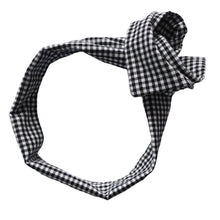 Overview of wide, black and white gingham headband with ends twisted into rosette. Wire framed head scarf/ head wrap. Headache free hair accessories. Rock, punk, glamorous, 20's, 50's, 60's, 70's, 80's, 90's, rockabilly, feminine, girly, preppy, minimalist, classic, natural, pretty style.