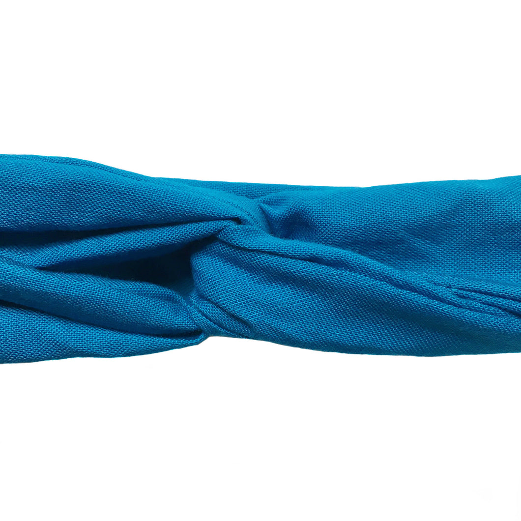 Close up of a cotton sky blue headband, cerulean wired head wrap, azure adjustable headscarf, bright blue headache free hair accessory. 31 inches long by 1.5 inches wide hair scarf.