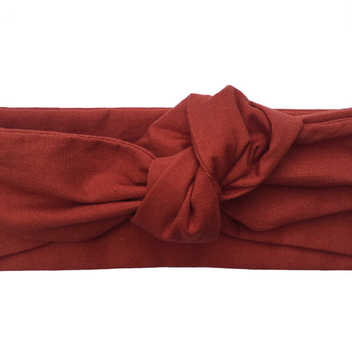 Close up of a cotton rust colored headband, Mahogany wired head wrap, Chestnut adjustable headscarf, Rich warm brown red headache free hair accessory. 36 inches long by 2.5 inches wide brick wired hair scarf.