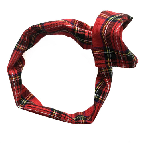 Overview of a red plaid headband with black, blue, yellow, and white plaid pattern on a white background. Wide, wire-framed headband with ends folded into bow/ knot shape. Headache free hair accessories. Classic, grunge, rock, rockabilly, bohemian, natural, preppy, school uniform, 50's, 60's, 70's, 80's, 90's style hair accessories.