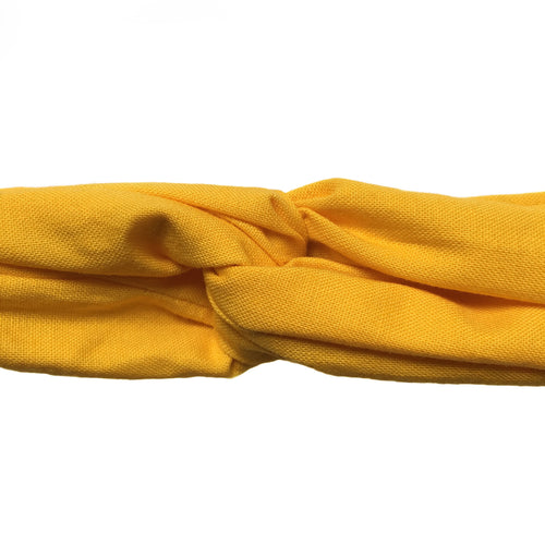 Closeup overview of warm yellow cotton wire framed headband. 31 inches long by 1.5 inches wide bandanna style head wrap. Gold, ochre, sunflower, turban style headband. Adjustable headache free hair accessory. Hair scarf. Headscarf.