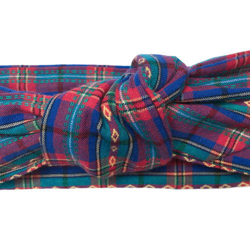 Close up of a blue, teal, pink and yellow  plaid cotton headband. Knit wire framed head wrap. Adjustable headscarf. Headache free wired hair accessory. 36 inches long by 2.5 inches wide wire framed hair scarf. Rockabilly pinup 50s 60s style headband. Madras plaid.