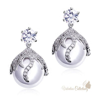 Platinum Plated Glamorous Cubic Zirconia plus imitation pearl drop earrings