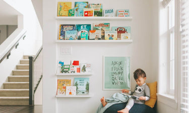 Children's books about kindness and empathy - toddler boy reading a book
