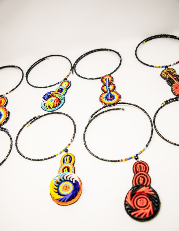 Chokers on memory wire with bead pendants on leather