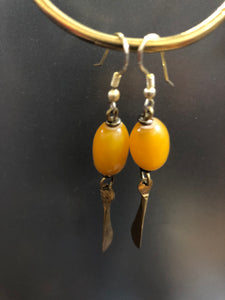 Yellow Amber like Bead with Brass details