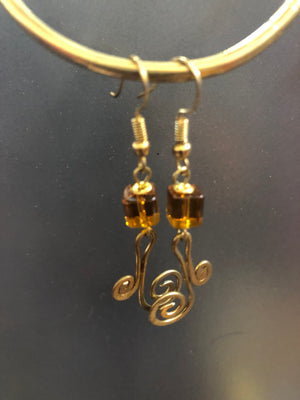Brass spiral earrings with bead details in a variety of colors