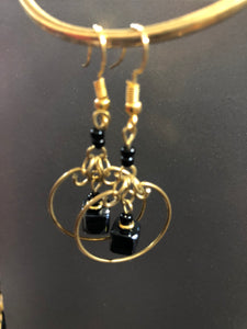 Brass earrings with black square bead details