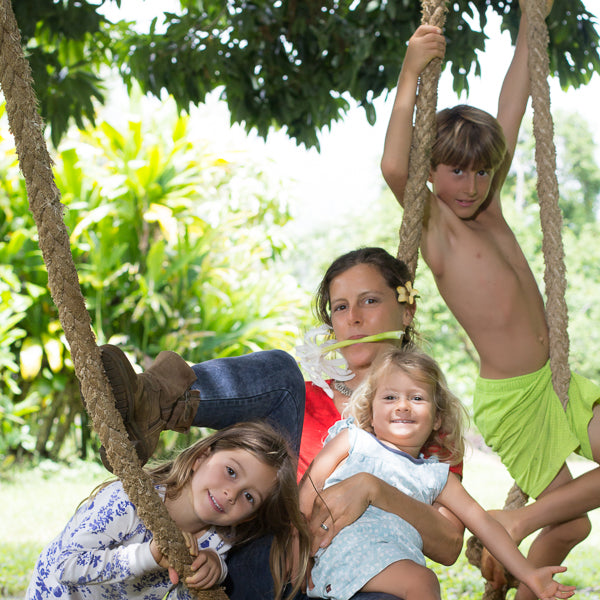 Genna with kids in tree swing
