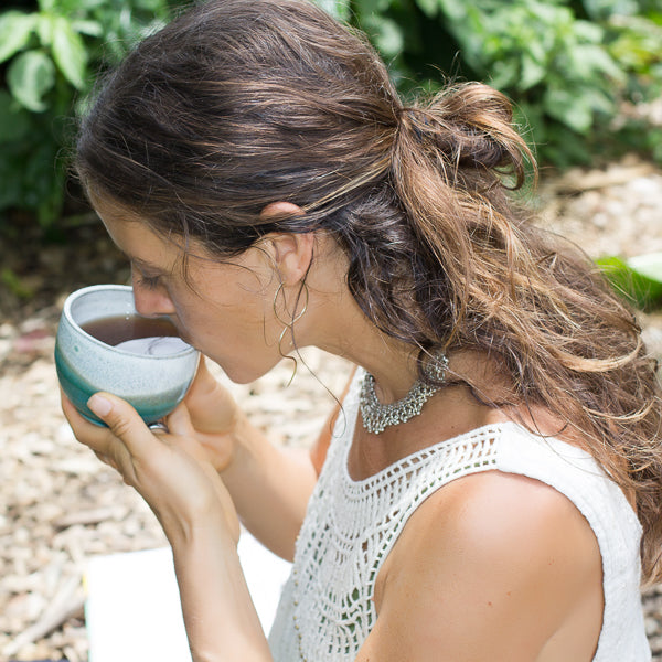 Genna with tea cup in garden