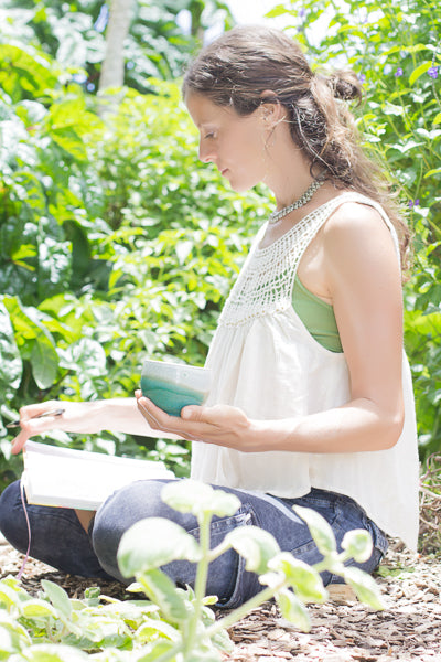 Genna in garden with tea cup and journal