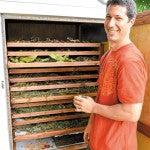 Doug Moeller in front of the solar-powered, ventilation-based drying system. Daniel Lane photos