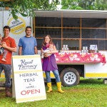 (from left) Doug Wolkon, daughter Ayva, Aaron Moeller, Genna Wolkon and daughter Rayna in front of Kauai Farmacy Tea Wagon in Kilauea