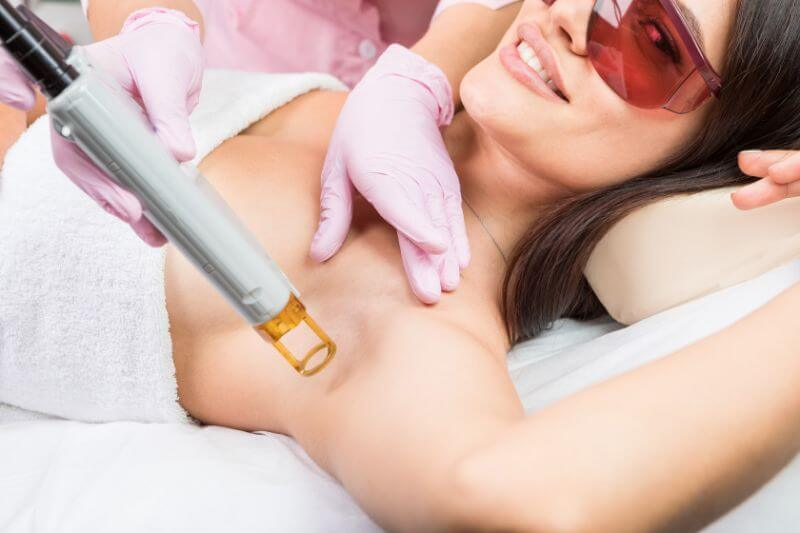 Woman getting laser hair removal procedure