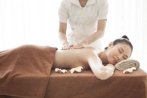 Spa therapist giving client a massage