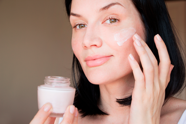 woman using her skincare routine for oily skin on the face