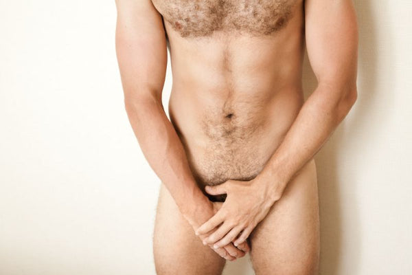 hairy man covering his private areas before his manzilian wax