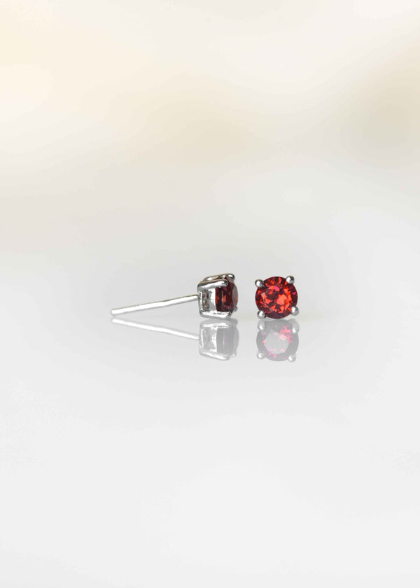 garnet studs earrings in sterling silver