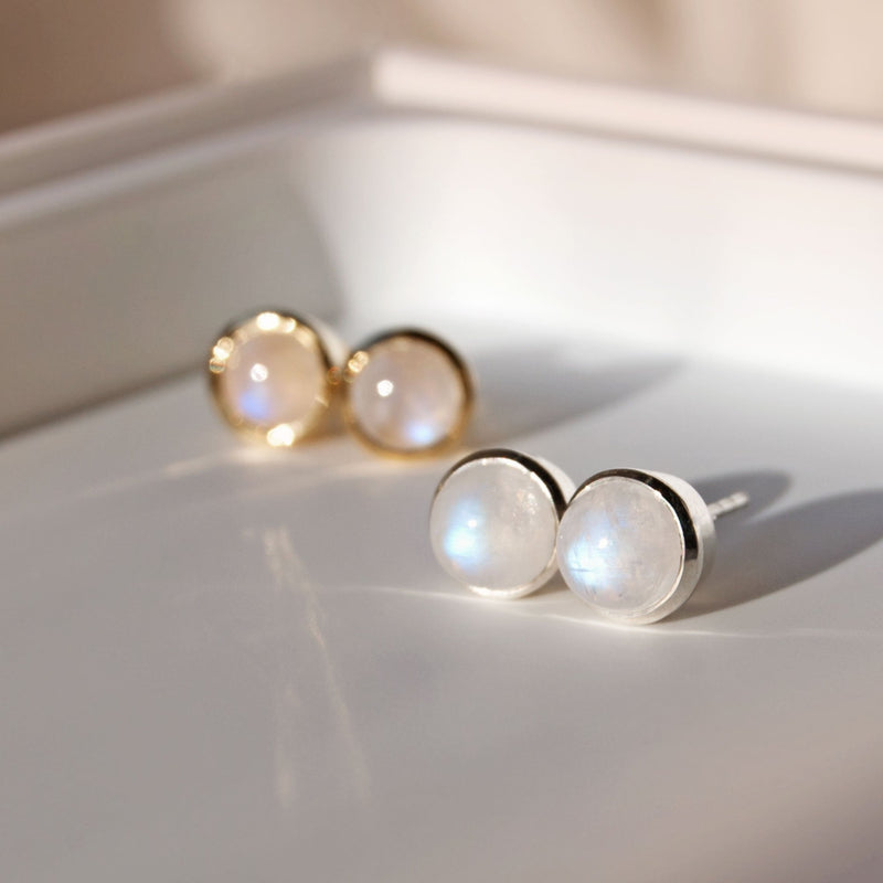moonstone stud earrings in silver and gold