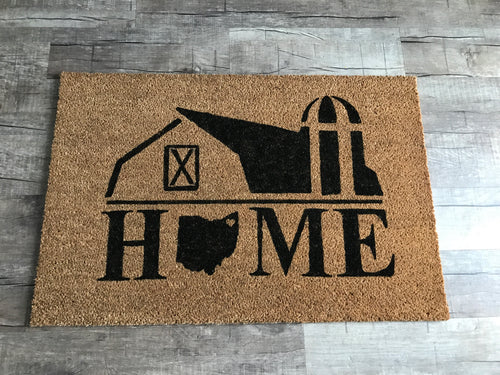 Barn home with Ohio doormat
