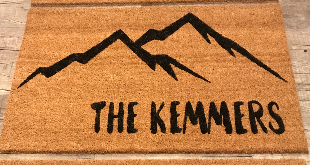 Mountains with last name doormat