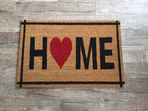 Home doormat with heart and border