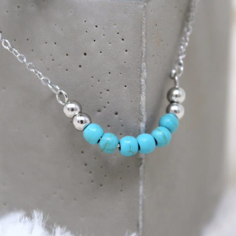 TURQUOISE BEAD CHARM NECKLACE