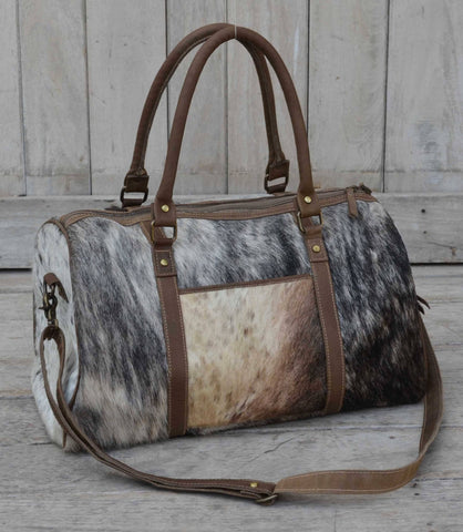 COWHIDE DUFFLE BAG Philbee Interiors