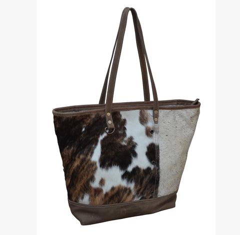 COWHIDE BOAT HANDBAG Philbee Interiors