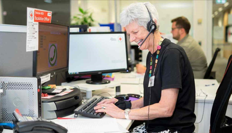 Photo of an operator of the Red Cross telecross service