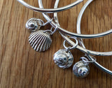 Thick round silver bangles with seashell charms - Handmade silver jewellery by Michelle Giles Jewellery