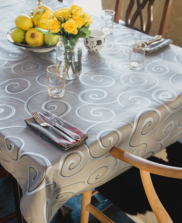 Silver and Black Swirls on Grey Tablecloth