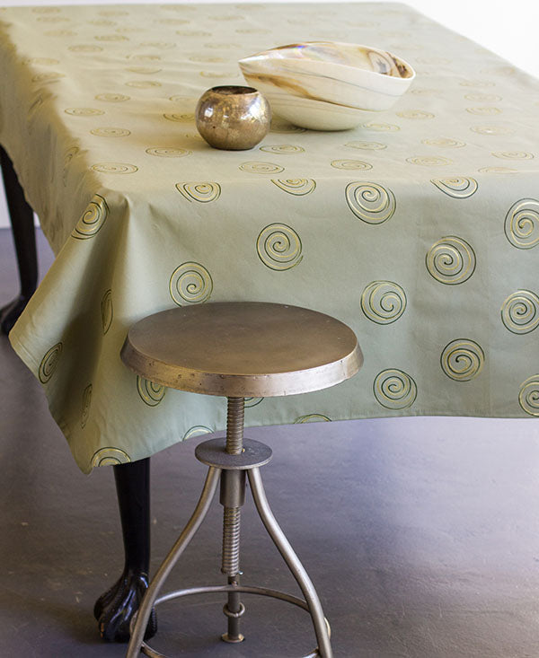 Gold Swirls on Taupe Tablecloth