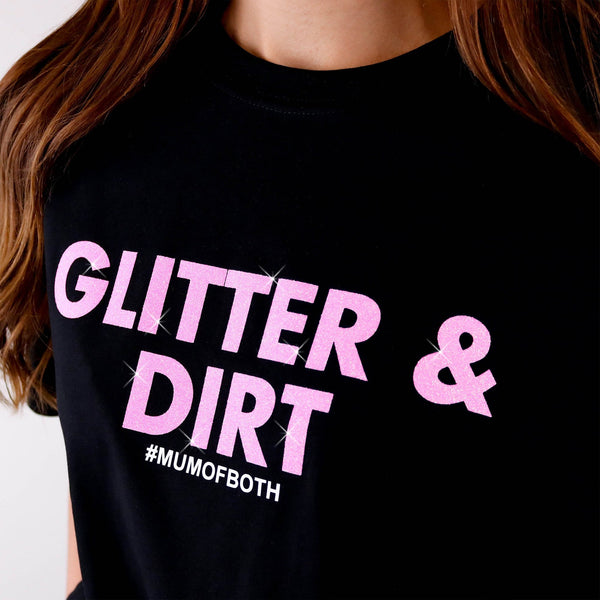 Woman wearing black T shirt with pink glittery text reading 'glitter and dirt #mum of both' by Original Monkey Gifts.
