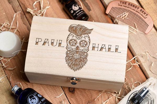 Wooden box on a wooden table top with engraved sugar skull and personalised engraving by Original Monkey Gifts.